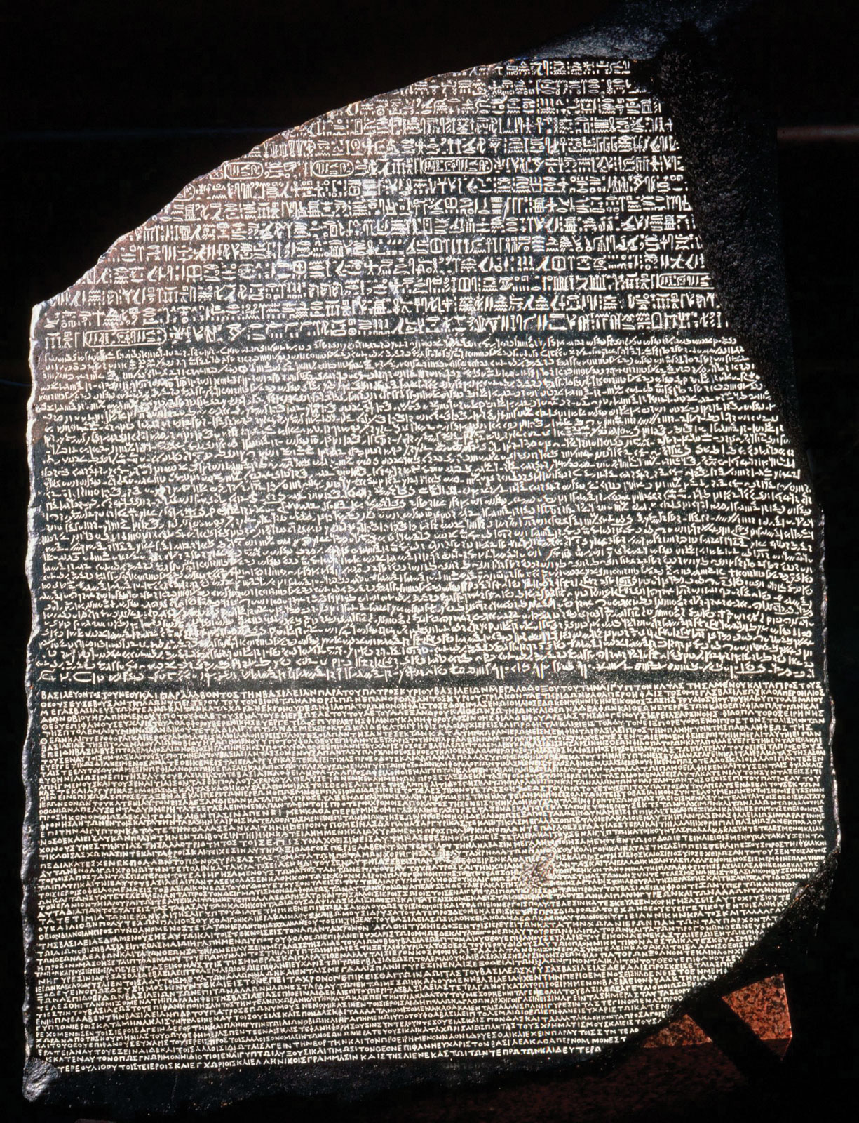 The Rosetta Stone basalt slab from Fort Saint-Julien Egypt 196 BCE in the British Museum London